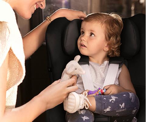 Kind in Kindersitz