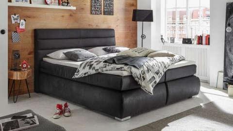 udoban crni tapecirani krevet