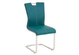 Houpací židle do jídelny petrolejové barvy.