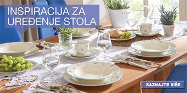 Tradicionalno uređen stol bijelim posuđem sitnog uzorka