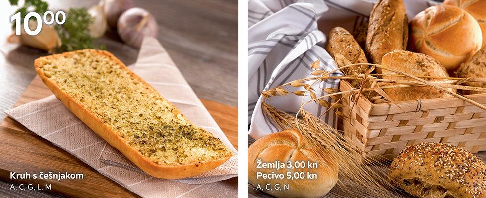 Kruh s češnjakom i žemlje u XXXL restoranu
