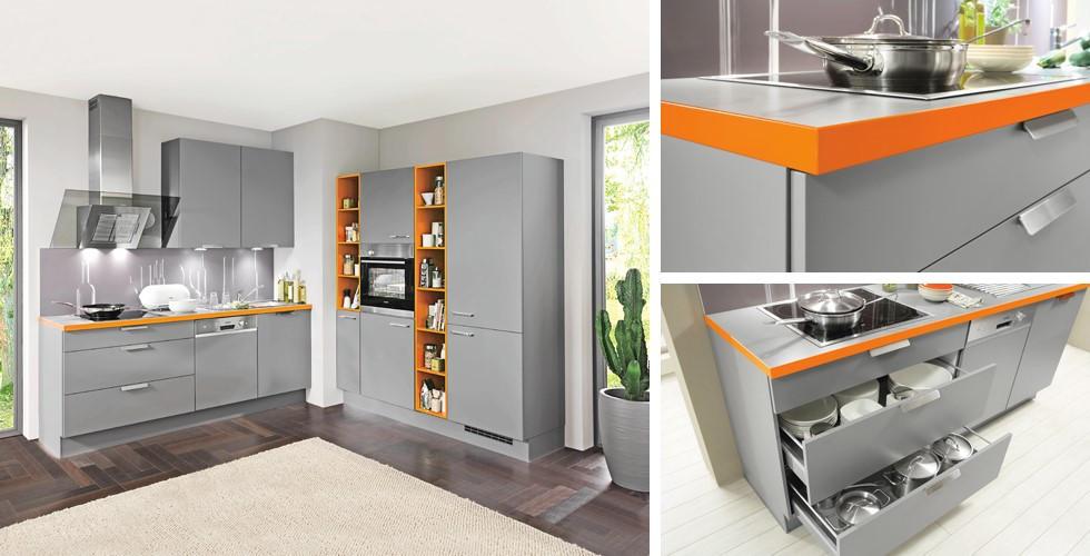 Küchenblock grau, orange Highlights, moderne Funktionen.