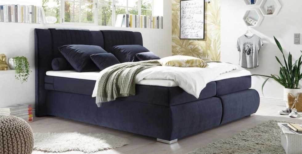 plavi boxspring krevet