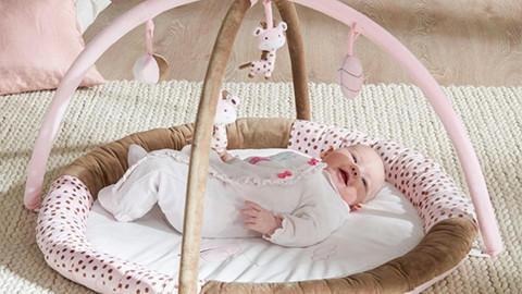 Spielbogen rosa mit Baby