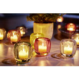 Lučice u šarenim svijećnjacima