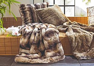 Hebká deka a kožešinový polštář: bytový textil od XXXLutz.