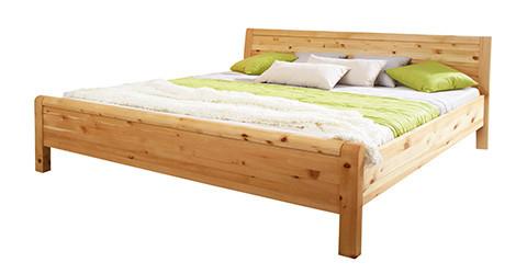 Zirbenschlafzimmer_Zirbenbett-gruene-Kissen