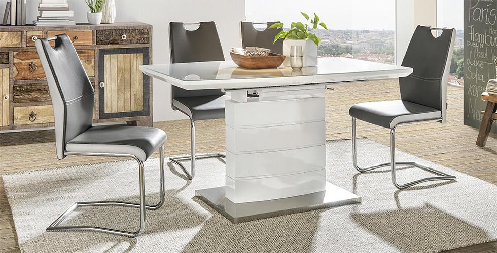 Bijeli blagovaonski stol sa sivo bijelim stolicama